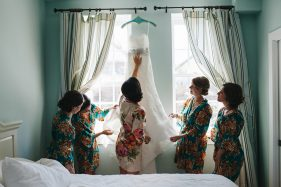 bride and her bridesmaid wearing pretty silk floral robes before the wedding ceremony in St. Augusting