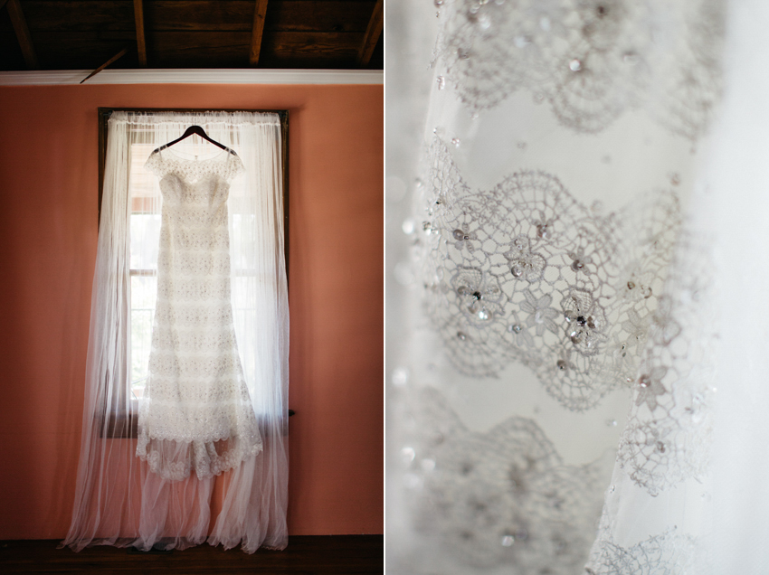 Beautiful beaded wedding dress by Alfred Angelo hanging in the window