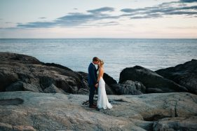 Romantic bride and groom photos on the cliff walk at sunset in Newport, Rhode Island