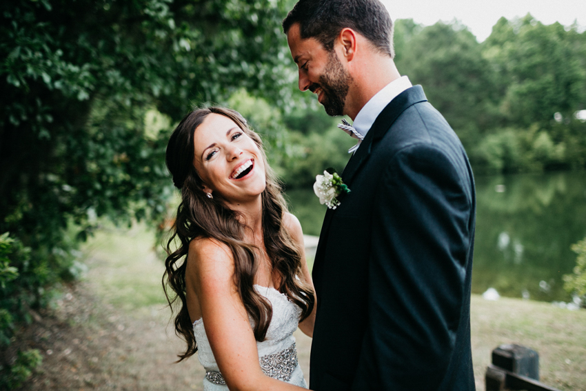 Happy candid wedding photos of the bride and groom laughing in the woods at their rustic Pepper Plantation wedding in Charleston