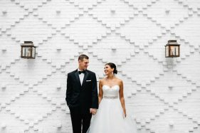 Industrial loft wedding venue with a exposed white brick wall in downtown Tampa