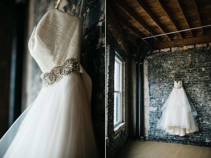 Beautiful Hayley Paige wedding dress hanging on a brick wall at the Oxford Exchange