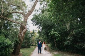 Creative boho wedding photos in the woods with lush greenery and rustic trees. Natural light wedding photography in Orlando by Renee Nicole Photography.