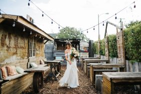 Candid photos of the bride dancing at 801 East Main The Poor Porker in downtown Lakeland