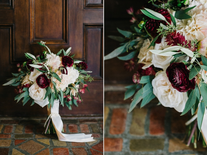 Lush organic bridal bouquet with greenery and maroon blooms