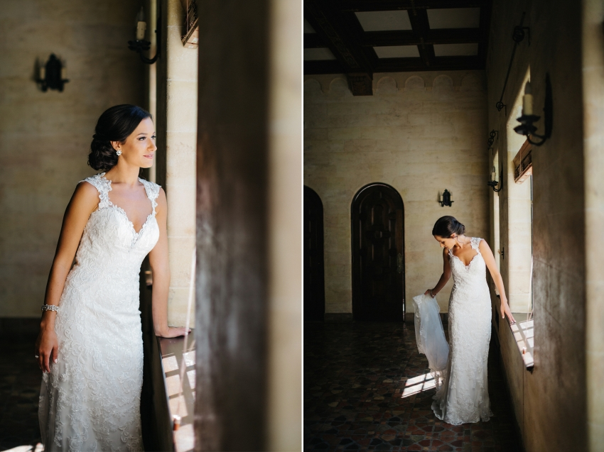 Moody bridal portraits with window light in the historic Powel Crosley bridal suite