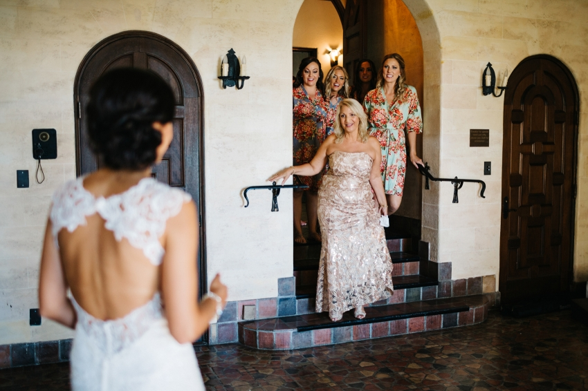 First look with the bridesmaids and mother of the bride wearing floral silk robes