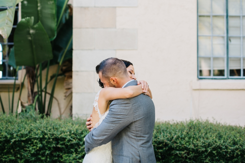 A sweet first look before the outdoor Sarasota wedding