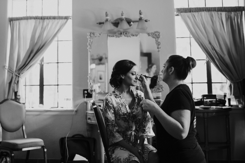 Bride getting her makeup done inside the bridal suite at the Powel Crosley Estate