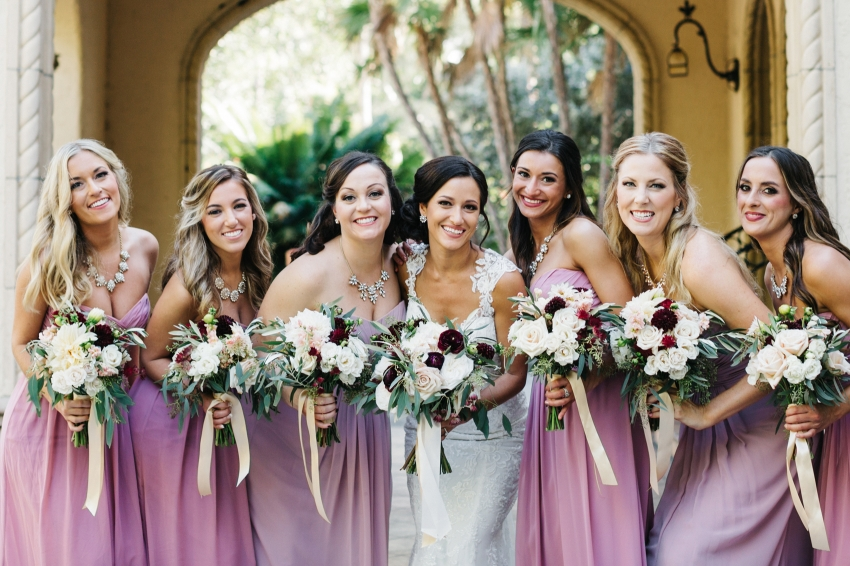 Bridesmaids wearing pink and muave dresses