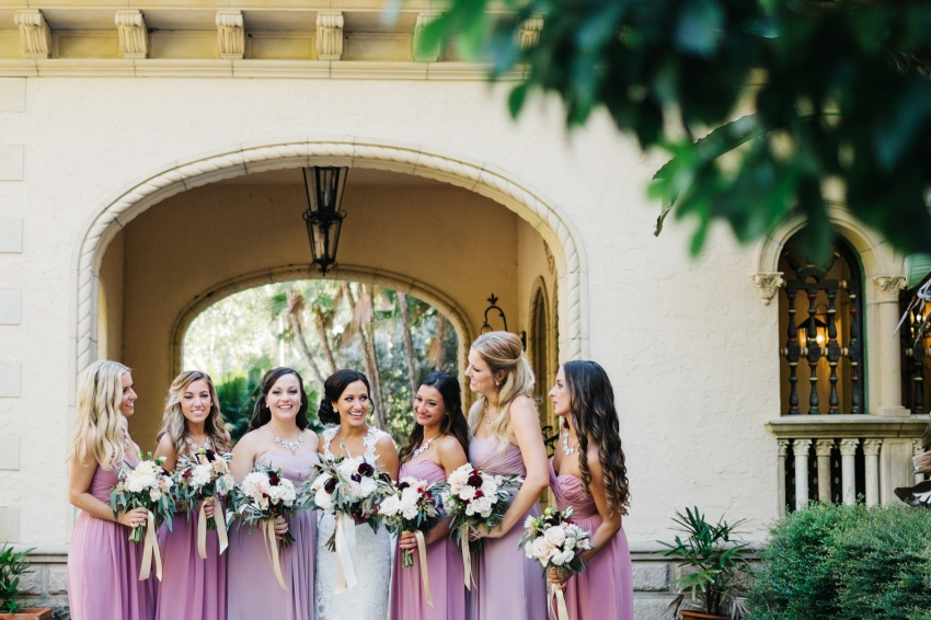 Candid photo of the bride laughing with her bridesmaids