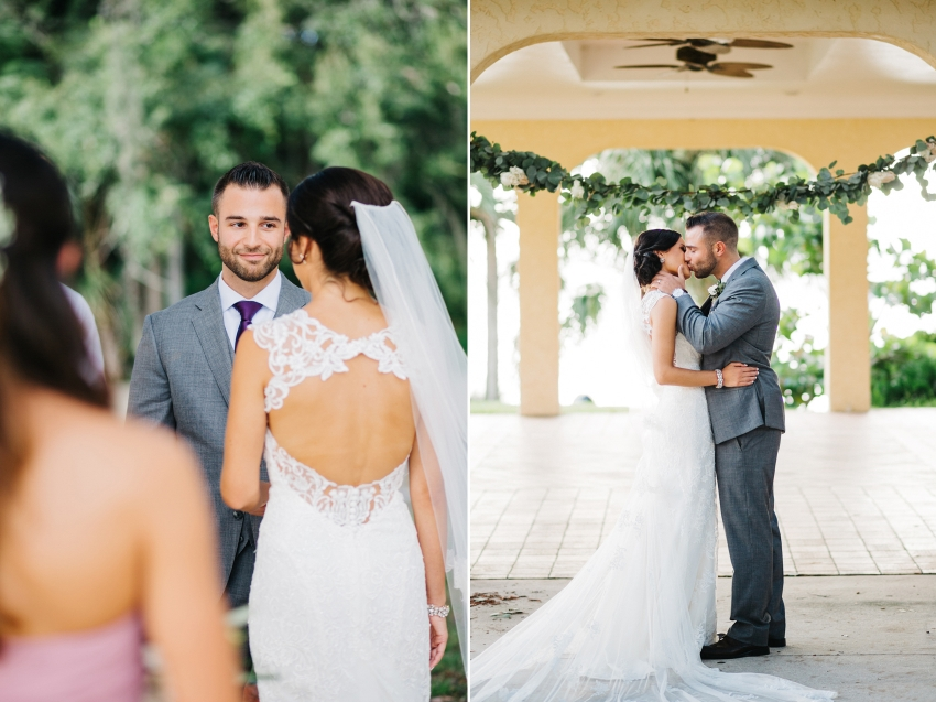 Exchanging vows and the first kiss under the greenery garland arch at the Powel Crosley Estate