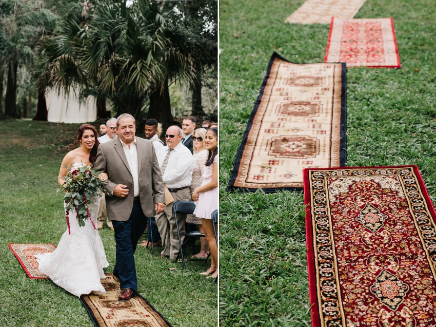 boho wedding ceremony with vintage rugs used for aisle runner