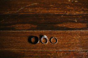vintage wedding rings on wood