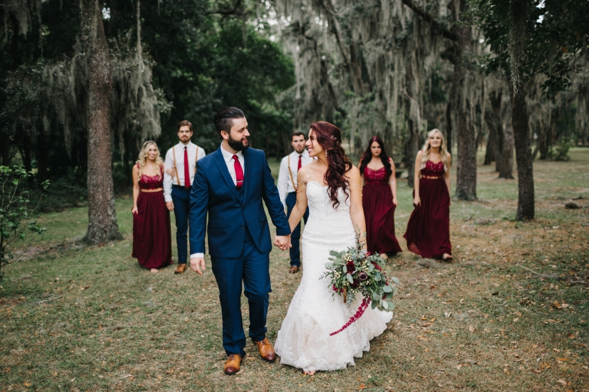 Burgundy and navy wedding party styling in the woods