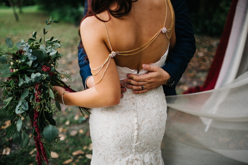 bride wearing jeweled bolero