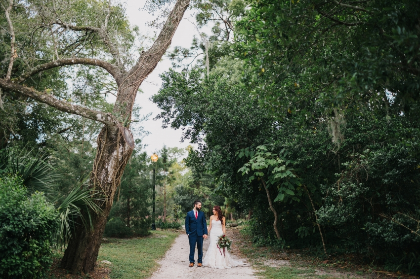 Woodsy natural wedding photos of the bride and groom at Mead Garden in Orlando