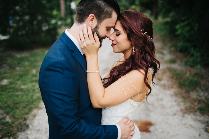 Sweet moment between the bride and groom before their Winter Park Farmers Market wedding reception