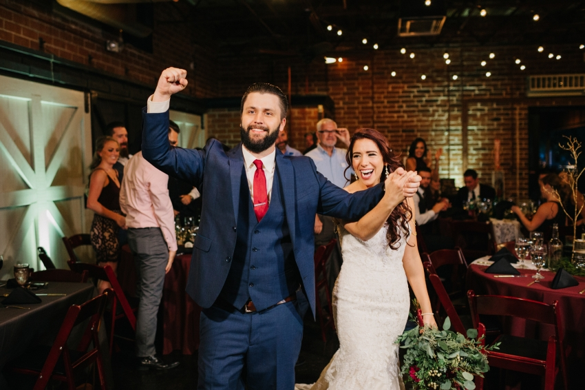 bride & groom cheering during the Orlando reception