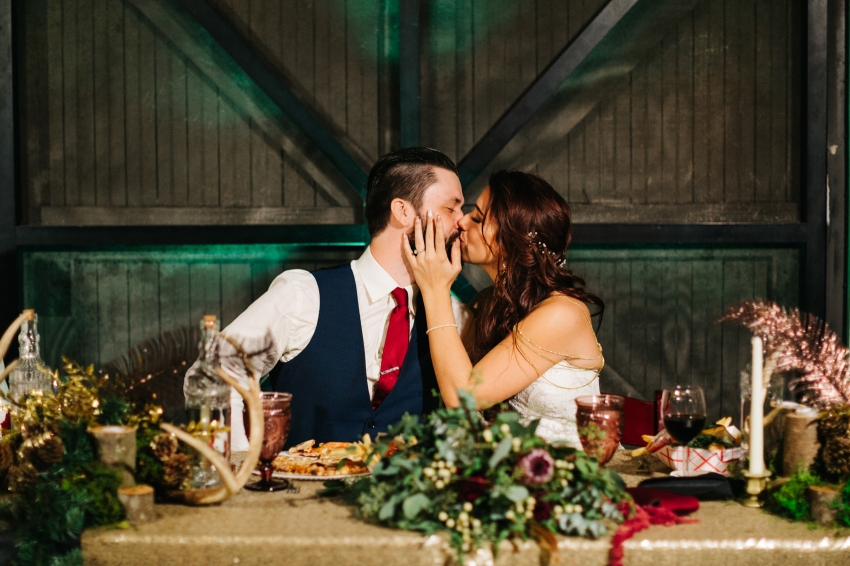 candid moment of the bride and groom kissing during the Orlando wedding reception
