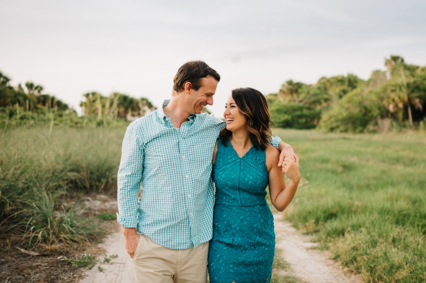Adorable couple laughing during engagement session in St. Pete Florida
