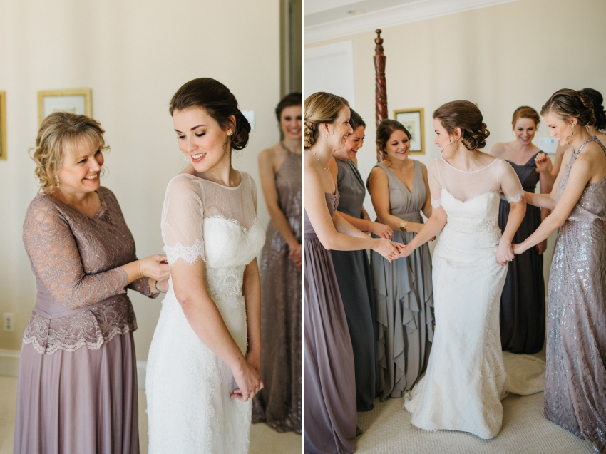 bridesmaids wearing mismatch lavendar dresses while they helpthe bride get ready for the first look in the garden