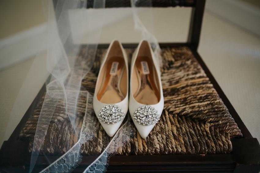 ivory Badgley Mischka wedding flats with a jeweled embellishment