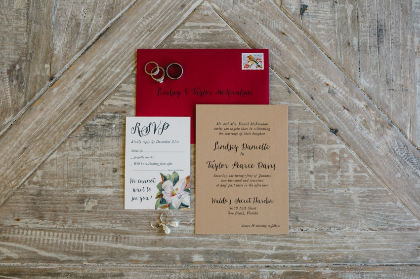 handmade wedding invtations with kraft paper and burgundy envelopes