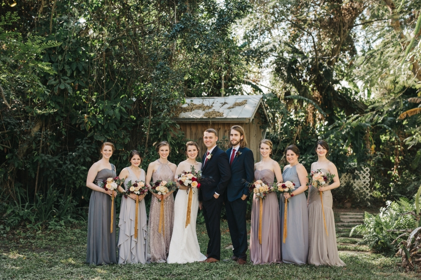 Mismatched bridal party wearing greys and lavendar