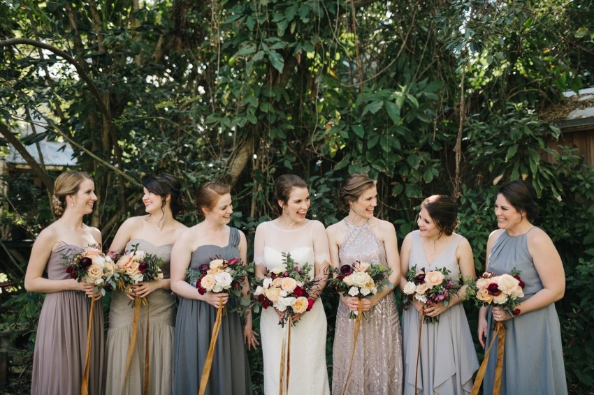 candid photo of the bride laughing with her bridesmaids in the garden before the ceremony at Waldo