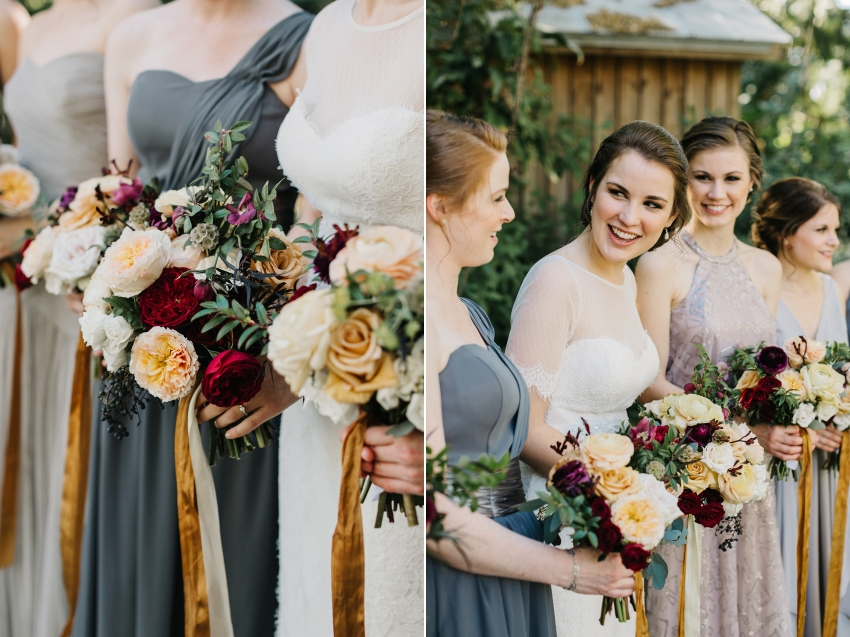 Burgundy, peach, and gold wedding bouquets with bridesmaids wearing mismatched grey dresses
