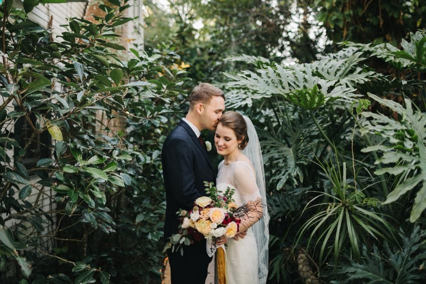 Sweet wedding photos in the garden at Orlando garden wedding venue