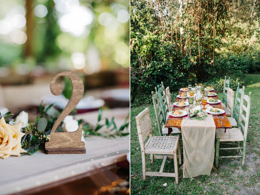 Wood table numbers, mismtached chairs, and wood farm table with mismatched woodland centerpieces by Orlando wedding photographer for outdoor garden wedding