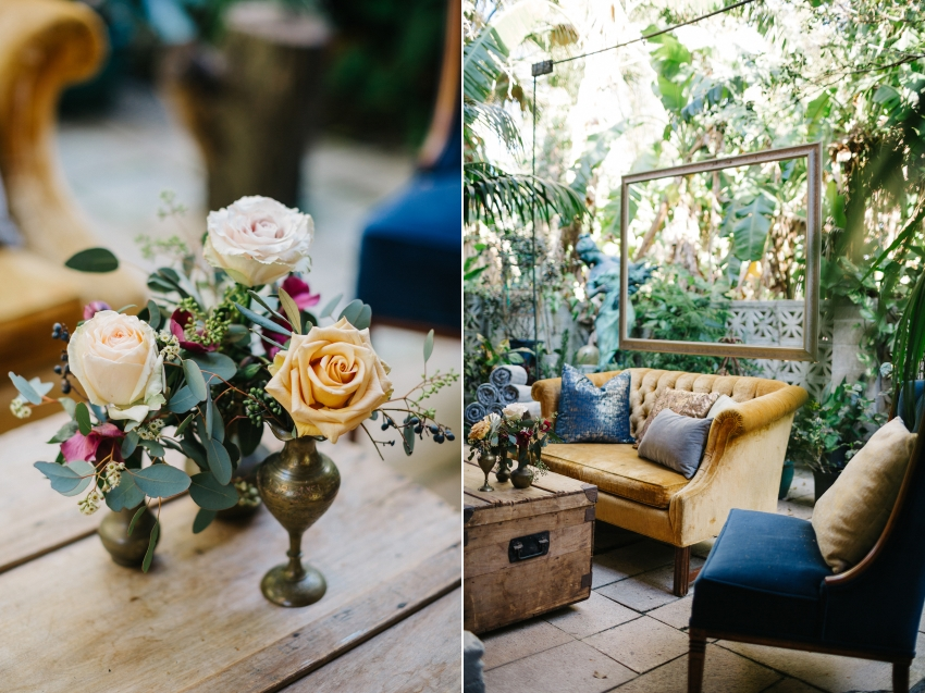 Wedding reception lounge with vintage navy chairs and mustard gold couch and vintage floral centerpiece
