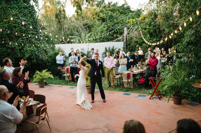first dance under the twinkle lights at outdoor garden wedding