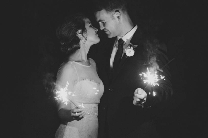 Orlando wedding photography at an outdoor garden with romantic black and white sparkler photo at the end of the reception