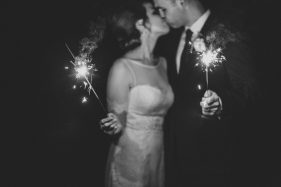 Romantic black and white sparkler photos of the bride and groom at outdoor garden Orlando wedding by Renee Nicole Photography