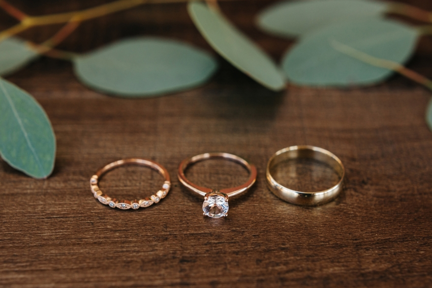 rose gold wedding rings with greenery