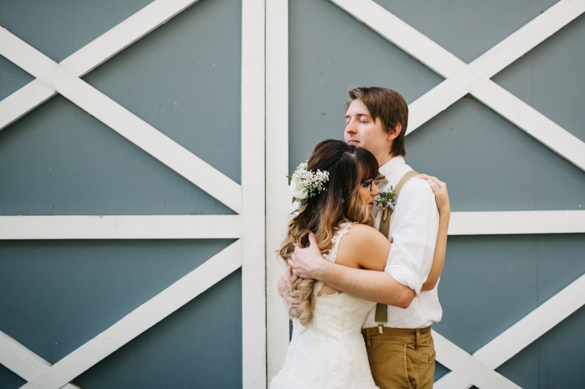 emotional first look with the bride and groom for their rustic wedding in florida