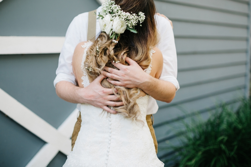 bride with baby breath and fresh flowers in her hair