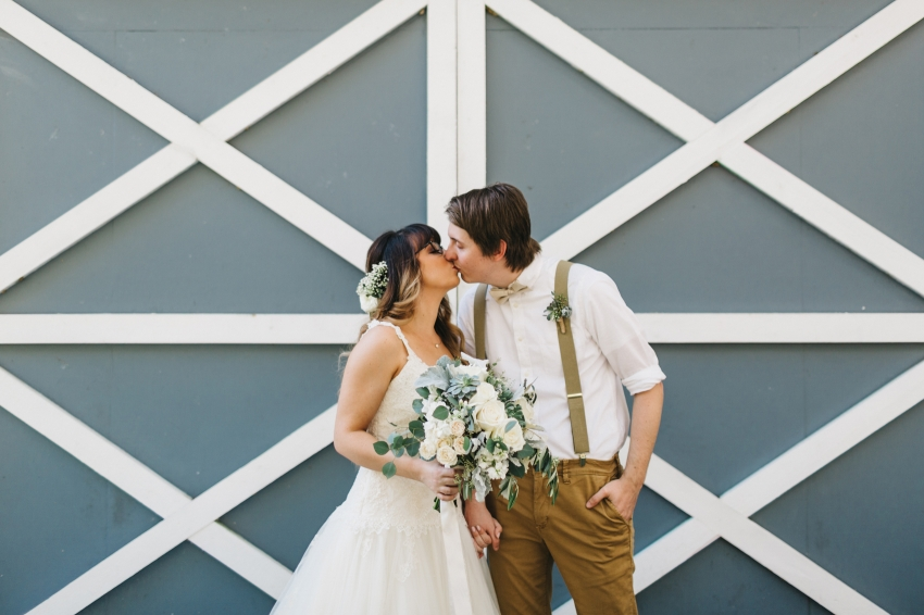 rustic wedding photos in front of the barn at the lange farm
