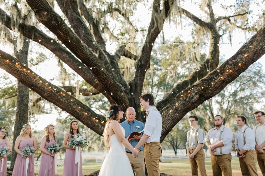 romantic ceremony under the oak trees at the lange farm