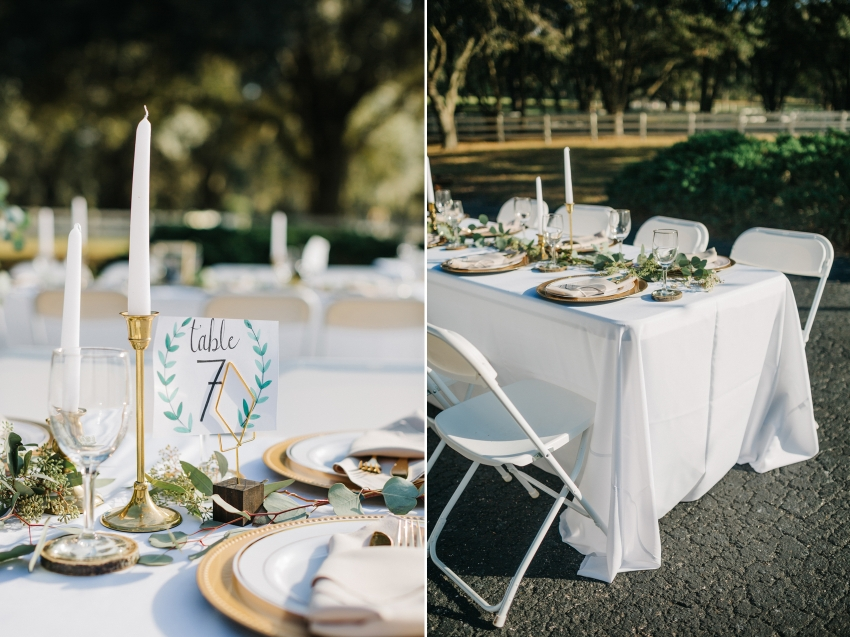 candle centerpieces and diy table numbers with gold accents for reception under the twinkle lights at the antique barn in tampa, florida