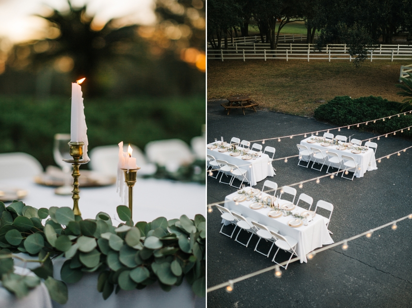 rustic outdoor reception in front of the antique barn at the lange farm with candlelight, greenery table runners, and string lights