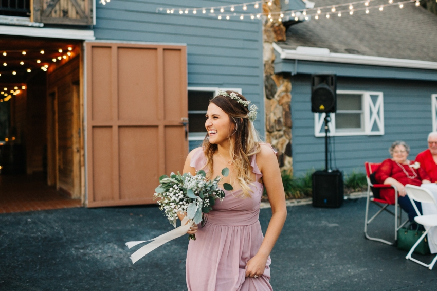 bridesmaid wearing a dusty pink dress and wearing a flower crown for outdoor rustic wedding in Tampa