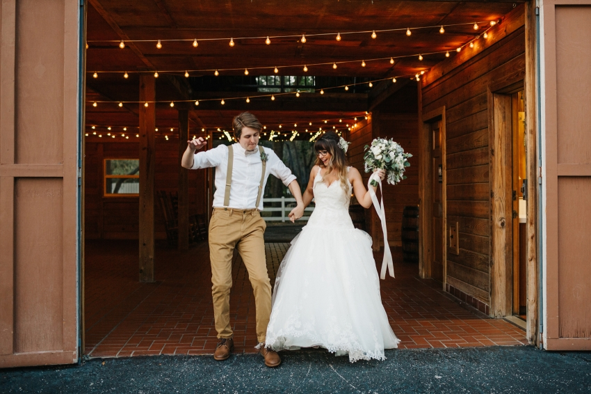 bride and groom dancing as the make their grand entrance at their barn wedding reception in Florida