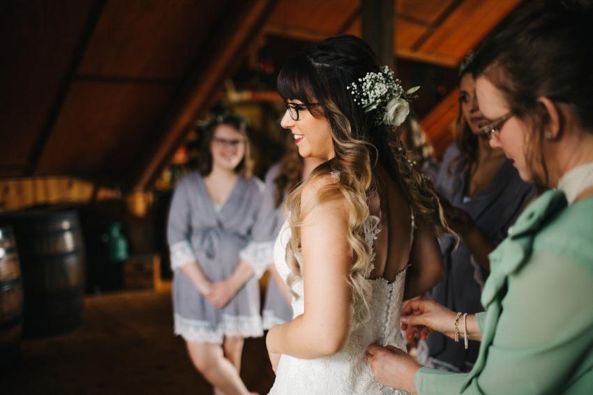 bride getting ready before rustic florida barn wedding