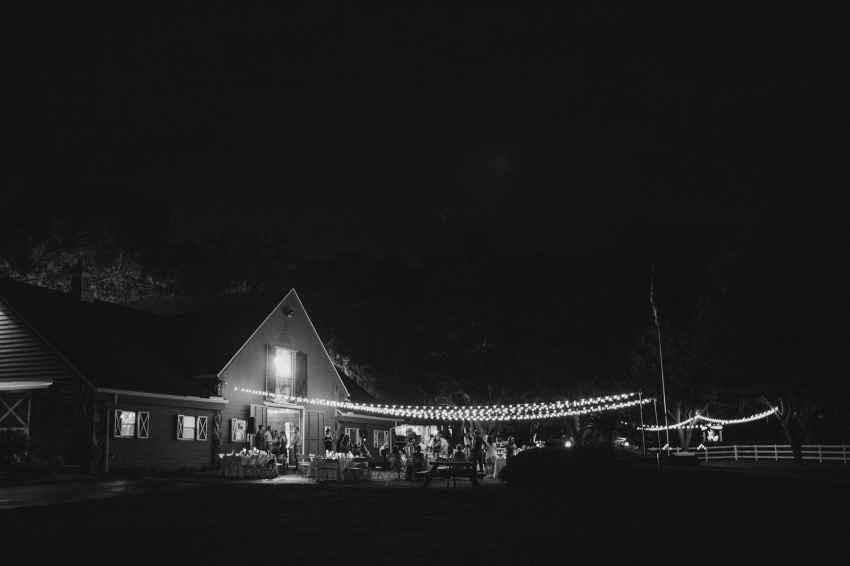 rustic florida barn wedding venue at nighttime with stringlights