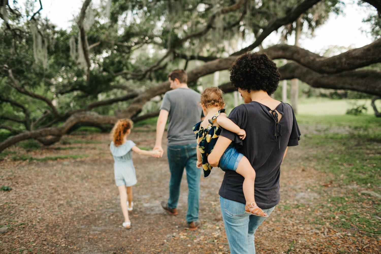 family walking under a big oak tree