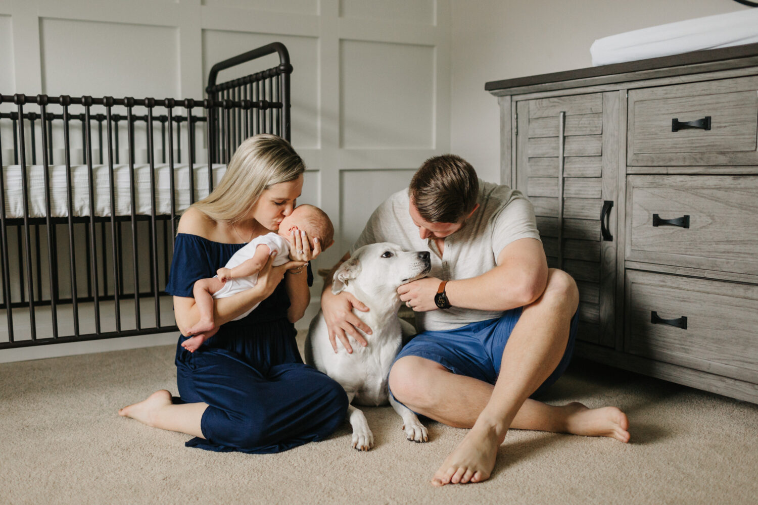 candid newborn photography with a dog